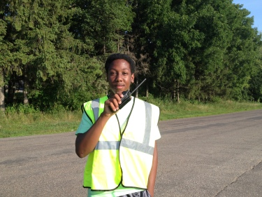 Sam announcing the incoming runner and directing traffic at Ragnar Exchange 6